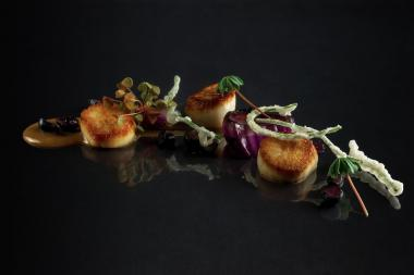 Senza, 2873 N. Broadway, earned a Michelin star in its first year in business. Here are the restaurant's scallops.