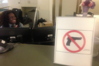 "Visitors at the School of the Art Institute of Chicago are greeted by a new sign of the times in Chicago — the official Illinois State Police ""No Guns Allowed"" symbol."