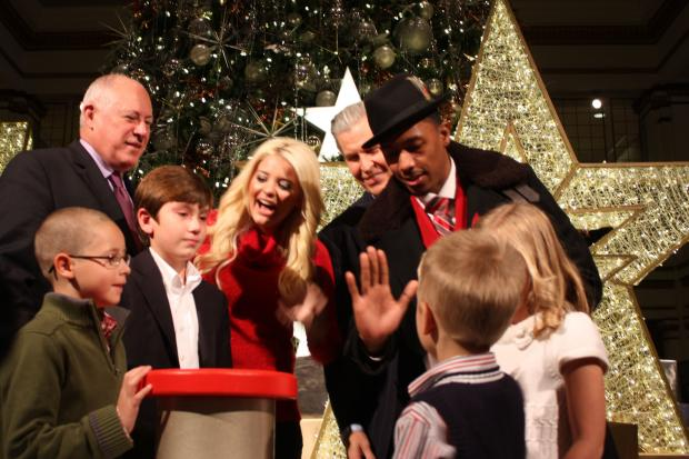 Entertainer Nick Cannon, former American Idol contestant Lauren Alaina and Gov. Pat Quinn were on hand Saturday for the 106th Annual Great Tree Lighting at Macy's State Street.