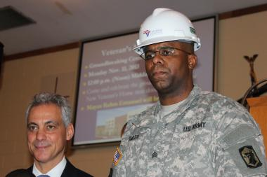 Army Sgt. Terry Smith Jr. (r.), who recently returned from a tour in Afghanistan, joined Mayor Rahm Emanuel at a groundbreaking ceremony on Veterans Day. A financial assistance program designed for veterans by ComEd could help Smith pay his electric bill.