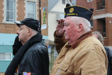 Timothy O'Mahoney (r), commander of American Legion Tattler Post 973, stands at attention during North Center's Veterans Day ceremony.