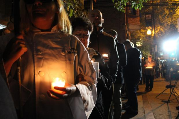 More than 100 mourners touched by Charlie Trotter over the years gathered outside his former restaurant Tuesday night.