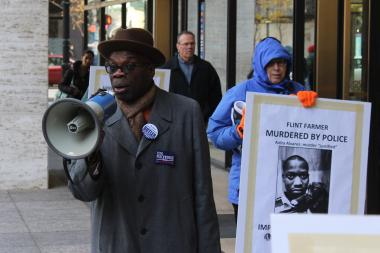 "Wallace ""Gator"" Bradley leads protesters outside the offices of Cook County State's Attorney Anita Alvarez."