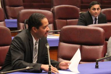 Ald. Anthony Beale proposes slashing the budget for the Council Office of Fincial Analysis as Ald. Ameya Pawar, one of the main backers of the independent budget office, looks on.
