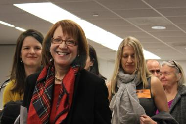 Ald. Michele Smith leads supporters of the Lincoln Elementary expansion out of the Board of Education meeting Wednesday.