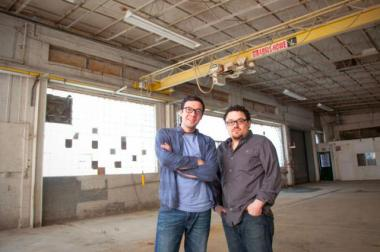 Brothers Samuel Evans (left) and Jesse Edwin Evans pose at the future site of Ale Syndicate Brewing in the Green Exchange Complex, 2601 W. Diversey Parkway.