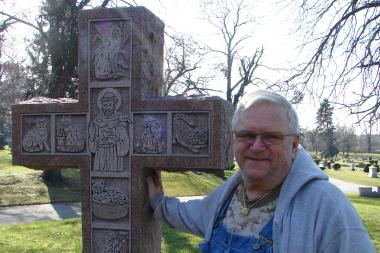 Dan Chaplick's ornate headstone at Mount Greenwood Cemetery features a self portrait, an intricate cross with engravings of his cats and the names of his 29 house pets.