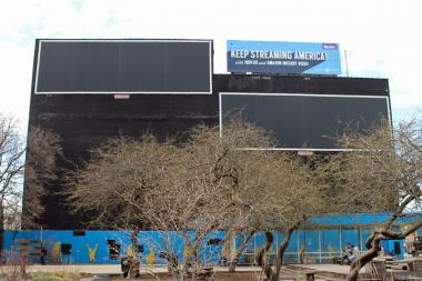 Blank billboard frames remain on the former Grace's Furniture building at 2616 N. Milwaukee Ave.