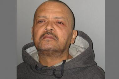 Jose Negrete, 57, is charged with two weapons violations after officers found an assault rifle and bullet-proof vest he allegedly threw from his window.