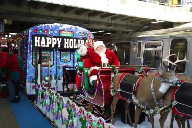 santa and the holiday train at the midway orange line station