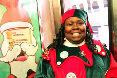 "CTA rail worker Pennie McCoach has been working on the holiday train every season since 2001. Her elf name is ""Mary."""