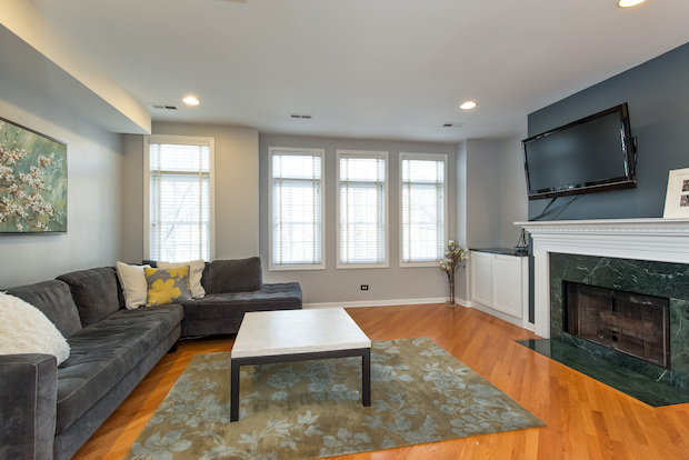 A two-bedroom condo unit that comes with a living room with a wood-burning fireplace is on the market for $419,900.