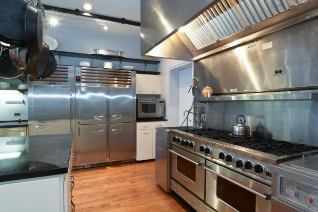 The kitchen inside 1821 N. Sedgwick St. comes with a 10-burner range and two dishwashers.