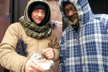 Kevin Govert (l.) and Marcus Faletti don't have a roof over their heads but say they are getting by in the snowy weather. But they could use more blankets and coats, they said.