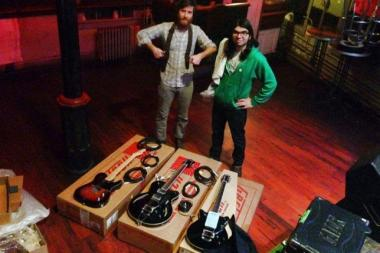 Members of Brass Bed pose with guitars donated by Fender. Someone burglarized the band's van following a show in Wicker Park, and made off with about $8,000 worth of gear. Fans and friends chipped in to replace almost all the gear for the Louisiana-based band.