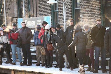 "Commuters wait for an ""L"" train during a January cold front. Monday's commute could be hampered by the expected frigid temperatures."