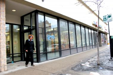 Debra Lewis, supervisor of the Wicker Park Post Office, stands in front of the branch's new post office store, set to open on Tuesday at 1240 N. Ashland Ave. in Wicker Park. The new quarters face Ashland Avenue, whereas the existing branch in the same shopping plaza faces a large parking lot.