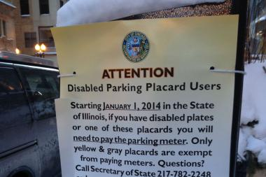 A sign on Lake Street Downtown explains the new handicapped parking regulations.