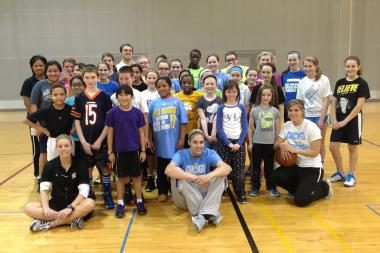 Elena Delle Donne poses with youth basketball players at a recent clinic. The Chicago Sky star hosts several clinics each year.