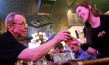 Bartender Bill Hemme and his daughter, Gillian Hemme, are a cocktail-serving duo at Four Farthings in Lincoln Park. Hemme met Gillian's mother, Teresa, at the corner tap in 1987.