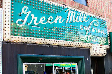 Uptown United wants businesses around Lawrence and Broadway to incorporate elements that mesh with the group's vision of a booming entertainment district. The Green Mill is known for its bright sign that lights up the intersection at night.