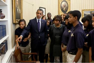 President Barack Obama showed students from Johnson College Prep and Principal Garland Thomas-McDavid a model of Samuel Morse's telegraph patent in the Oval Office during their visit to the White House, Oct. 28, 2011.