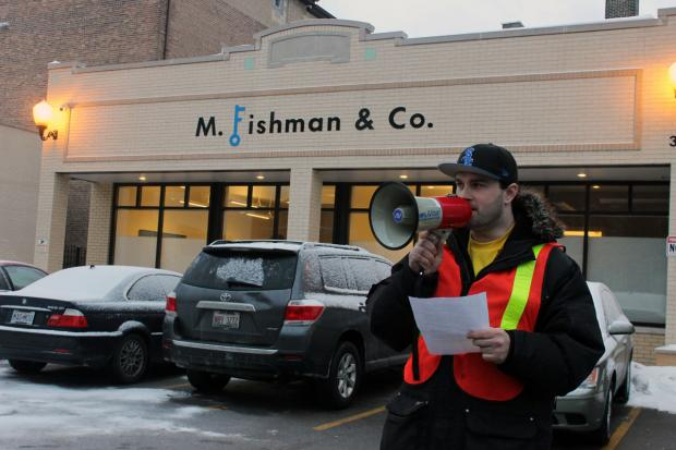 Dozens of residents of a building recently acquired by M. Fishman & Co. protested outside its offices Thursday afternoon.