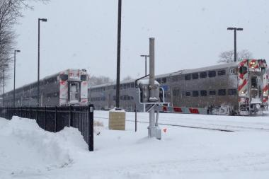Two Metra trains stop at the Edison Park station.