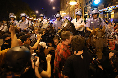 Protesters, some affiliated with the Occupy Wall Street movement, briefly clash with police as they demonstrate in downtown Chicago on the eve of the NATO summit on May 19, 2012 in Chicago.