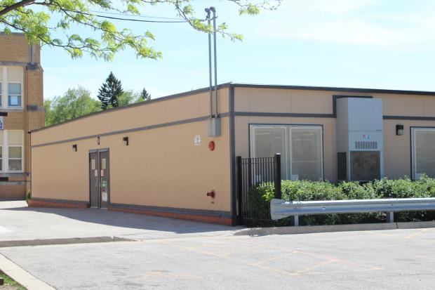 Water service was restored Friday to Oriole Park Elementary School's modular building.
