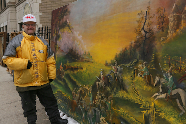 Serbian immigrant Ratko Ikic displays his art on the fence outside his apartment building on Ashland Avenue.