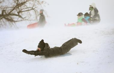 A child sleds Thursday at Humboldt Park.