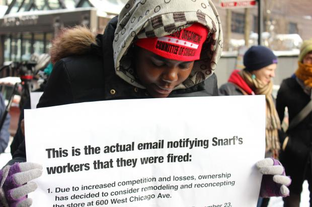 Former employees of Snarf's sub shop, and workers rights' activists, braved the cold to protest outisde the Loop location Wednesday.