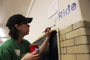 A volunteer paints a wall at Sullivan High School in honor of Martin Luther King Jr. Day this year. (file)