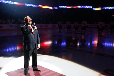 Wayne Messmer, senior executive vice president for the Chicago Wolves, sings the national anthem at Allstate Arena.