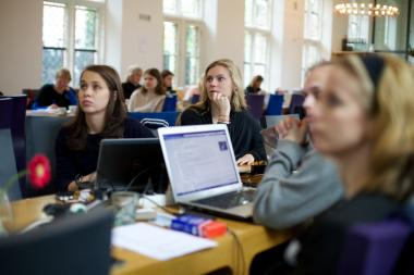 Women edit Wikipedia entries at an Edit-A-Thon hosted at the Netherlands Institute for Sound and Vision.