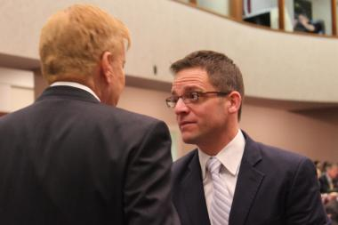 Ald. Joe Moreno talks with Ald. Bob Fioretti during Wednesday's City Council meeting.