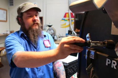Dennis Jackson, Bow Truss master roaster, checks out his latest roast.