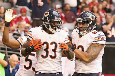 Cornerback Charles Tillman (33) of the Chicago Bears celebrates with defensive tackle Stephen Paea (92) after scoring a 10-yard interception touchdown against the Arizona Cardinals in 2012.