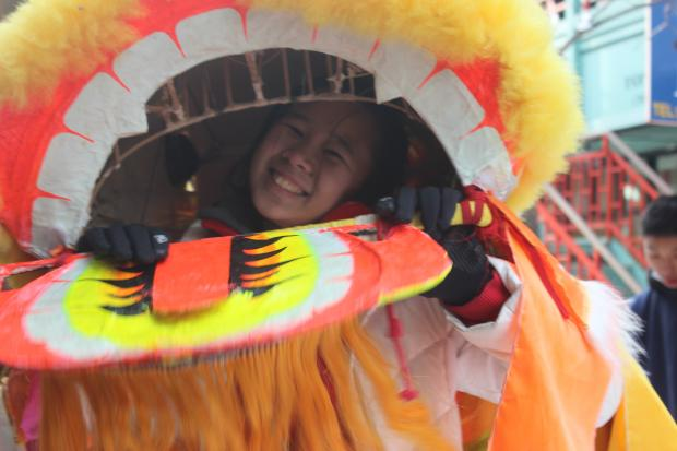 High-flying dragons and traditional lion dancers entertained hundreds of revelers in Chinatown Sunday.