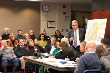Architect Joe Antunovich explains the proposal from the Children's Memorial Hospital redevelopment to neighborhood residents at a meeting held by the Mid-North Association Tuesday night.