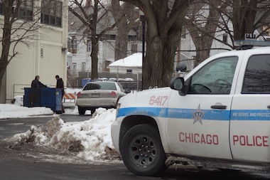Police investigate the fatal stabbing of a man in Englewood on Friday, Feb. 14, 2014.