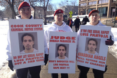 Chicago's Guardian Angels brought signs calling for swift justice.