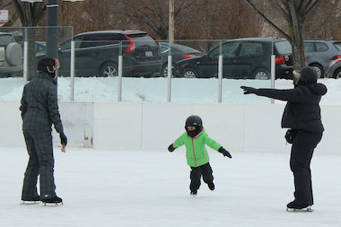 Angelica Akerele-Ale, 4, of South Shore, skating with her mother Adedunla, right, and her skating coach Denise Darling, left.