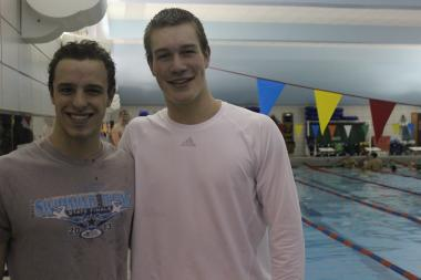 (From left) Seniors Jacob Cruger and Matt Rauner at Friday's swim meet with Latin alumni. The meet was a substitute for Senior Night, which was cancelled last week.