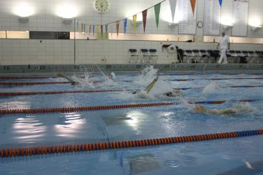 The Latin men's swim team faces off against Latin alumni at a meet Friday. The meet was organized as an alternate senior night after the team's last home meet was cancelled last week.