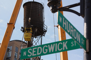 "Crews safely took down a leaning River North water tower a day after it sent down ""torrential downpour"" on the building it sits atop at 409 W. Huron St."