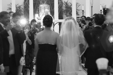 A wedding ceremony at Loyola University's Madonna della Strada Chapel in Rogers Park