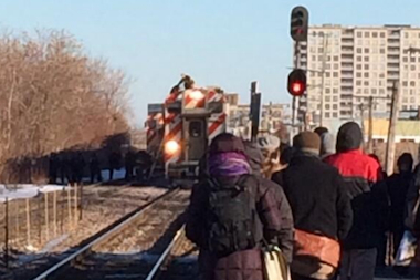 A man climbed atop a Metra train in Rogers Park Monday morning.