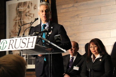 Mayor Rahm Emanuel cheers the opening of the Road Home Program for veterans at Rush University Medical Center Friday as U.S. Rep. Tammy Duckworth (r.) looks on.